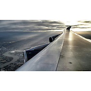 British Airways wing of a Boeing 747 flying over London