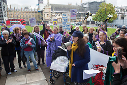 London, UK. 5 November, 2019. Amelia Womack, Deputy Leader of the Green Party, addresses campaigners from WASPI (Women Against State Pension Inequality) protesting in Parliament Square to call for fair transitional pension arrangements for women born in the 1950s affected by the changes to the State Pension Age (SPA), including a 'bridging' pension to provide an income from age 60 until State Pension Age and recompense for losses incurred by women who have already reached their SPA.