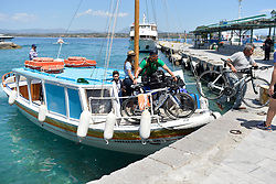 Triathletes arriving by water taxi at the 5th Spetsathlon