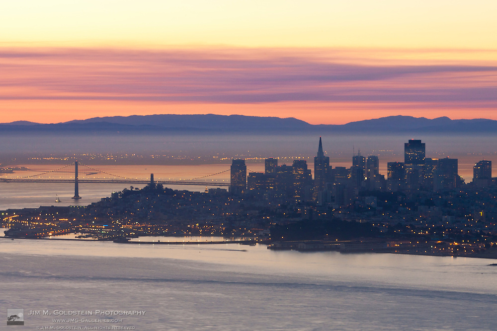 Pre-dawn light shines across the San Francsisco bay and skyline