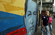 Caracas, Venezuela<br />Murals of Venezuelan president Hugo Chavez. Large murals depict Chavez alongside other revolutionary leaders have been painted around the Venezuelan capital, notably in poor districts, part of a growing cult of personality centred around Chavez.