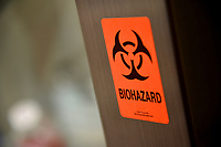 Biohazard warning label on a hood in a microbiology lab.