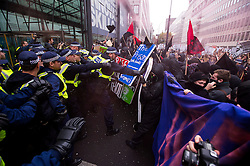 © Licensed to London News Pictures. 04/11/2015. London, UK.   Demonstrators clash with police outside the Department for Business Innovation and Skills as Thousands of students take part in a demonstration in central London against tuition fees. The rally which starts outside the University of London Union, will feature a speech from Shadow Chancellor John McDonnell.  Photo credit: Ben Cawthra/LNP