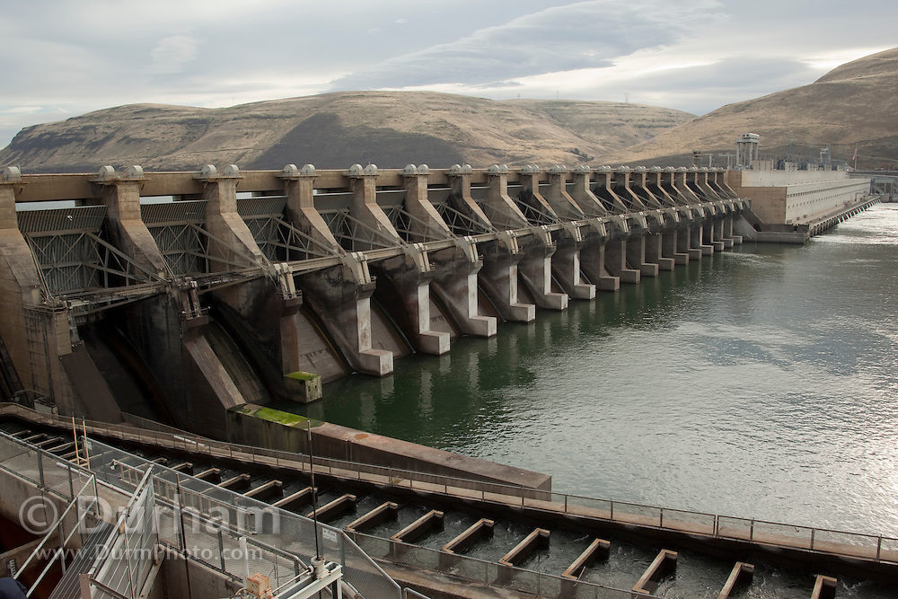 The John Day Dam on the Columbia River with fish ladders visible in the foreground.