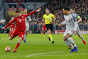 Bayern Munich forward Robert Lewandowski (9) shoots during the Champions League match between Bayern Munich and Liverpool at the Allianz Arena, Munich, Germany, on 13 March 2019.