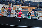 Passengers on the Wylde Swan - Royal Greenwich Tall Ships Festival with a fleet of square rigged ships moored on the Thames at Greenwich and Woolwich. The fleet includes two of the biggest Class A Tall Ships - the Dar Mlodziezy and Santa Maria Manuela - which are moored on Tall Ships Island in the river off Greenwich. Tall Ships Festival Day on Saturday 29 August featured free family entertainment and the chance to enjoy a taste of life on the high seas.