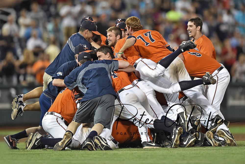 Players of the Virginia Cavaliers celebrate after beating the Vanderbilt Commodores 4-2 to win the National Championship, during game three of the College World Series Championship Series at TD Ameritrade Park in Omaha, Nebraska.