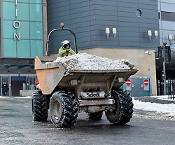 Pictured:Workers on the new St James development in Edinburgh used their equipment to clear snow in the city centre on Thursday morning.<br /> <br /> The severe winter weather continued to cause chaos throughout Scotland, with the most severe level of Amber warning being extended until 10am on Friday 02 March.<br /> <br /> &copy; Dave Johnston / EEm
