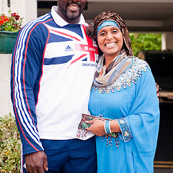 London, UK - 21 July 2012: Team GB Olympic discus thrower Abdul Buhari poses with his wife at the Ramadan Iftar 2012 celebrations hosted at the Islamic Cultural Centre (ICC) in Regents Park.