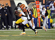Cincinnati Bengals cornerback Dre Kirkpatrick (27) chases Pittsburgh Steelers wide receiver Martavis Bryant (10) as Bryant runs a third quarter reverse for a gain of 44 yards and a first down at the Cincinnati Bengals 20 yard line during the NFL AFC Wild Card playoff football game against the Cincinnati Bengals on Saturday, Jan. 9, 2016 in Cincinnati. The Steelers won the game 18-16. (©Paul Anthony Spinelli)