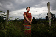 Naw K'nyaw Paw of the Karen Women's Organization in the fenced compound of their Thai headquarters in Mae Hong Son Province. The organisation has 60,000 members and works to fight for the rights of Karen women and children in Myanmar and Thailand.