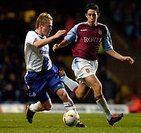 Photo: Richard Lane.<br />Aston Villa v Chelsea. Carling Cup. 17/12/2003.<br />Damien Duff goes past Peter Whittingham.