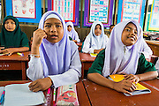 11 JULY 2013 - PATTANI, PATTANI, THAILAND:   Students in an English class at the Bantaladnadklongkud School in Pattani. There are 108 students at Bantaladnadklongkud School and they are all Muslims. Five of the school's eight teachers are Buddhists.    PHOTO BY JACK KURTZ