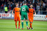 Dundee United forward Scott McDonald (#8) congratulates Dundee United goalkeeper Harry Lewis (#25) following the penalty shoot-out during the Betfred Scottish Cup group stage match between Dundee and Dundee United at Dens Park, Dundee, Scotland on 29 July 2017. Photo by Craig Doyle.