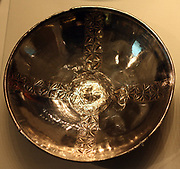Shallow bowls. A set of ten small silver bowls was deposited in the burial chamber at Sutton Hoo. They were stacked upside down and many of them survived in excellent condition. The Byzantines used such bowls to serve food, and perhaps the Anglo-Saxons did so as well. Although they are decorated with cross-shaped bands, the bowls probably did not have Christian meaning. AD 500s-600s Eastern Mediterranean