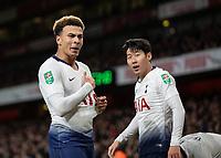 Football - 2018 / 2019 EFL Carabao Cup (League Cup) - Quarter-Final: Arsenal vs. Tottenham Hotspur<br /> <br /> Dele Alli (Tottenham FC)  touches the Tottenham crest on his shirt after scoring his teams second goal at The Emirates.<br /> <br /> COLORSPORT/DANIEL BEARHAM