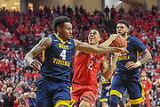 LUBBOCK, TX - JANUARY 13: Zhaire Smith #2 of the Texas Tech Red Raiders goes to the basket against Daxter Miles Jr. #4 of the West Virginia Mountaineers during the game on January 13, 2018 at United Supermarket Arena in Lubbock, Texas. Texas Tech defeated West Virginia 72-71. (Photo by John Weast/Getty Images) *** Local Caption *** Zhaire Smith;Daxter Miles Jr.