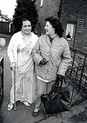 Elderly Asian woman & carer, UK 1989