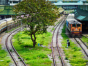 25 NOVEMBER 2017 - YANGON, MYANMAR: A Yangon Circular Train in Yangon Central Station. The Yangon Circular Train is a 45.9-kilometre (28.5 mi) 39-station two track loop system connects satellite towns and suburban areas to downtown. The train was built during the British colonial period, the second track was built in 1954. Trains currently run both directions (clockwise and counter-clockwise) around the city. The trains are the least expensive way to get across Yangon and they are very popular with Yangon's working class. About 100,000 people ride the train every day. A a ticket costs 200 Kyat (about .17¢ US) for the entire 28.5 mile loop.    PHOTO BY JACK KURTZ