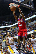 April 21, 2012; Indianapolis, IN, USA; Philadelphia 76ers forward Thaddeus Young (21) dunks the ball over Indiana Pacers small forward Danny Granger (33) at Bankers Life Fieldhouse. Mandatory credit: Michael Hickey-US PRESSWIRE