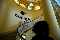 "A visitor poses for photos in front of the Cohiba cigar logo at the ""El Laguito"" factory in Havana, capital of Cuba, on March 3, 2016. Cohiba is the flagship brand of Cuban cigar. It was first created in 1966 for Cuban revolutionary leader Fidel Castro himself and was then top secret. It soon became Cuban gifts for heads of state and visiting diplomats. Since 1982 Cohiba has been available in limited quantities to the open market. The name ""Cohiba"" is an ancient Taino Indian word for the bunches of tobacco leaves that Columbus first saw being smoked by the original inhabitants of Cuba. EXPA Pictures © 2016, PhotoCredit: EXPA/ Photoshot/ Liu Bin<br />