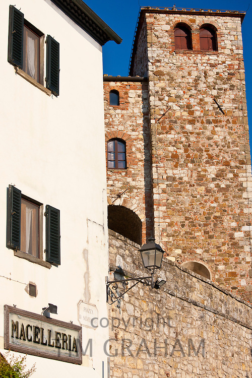 Macelleria and ancient fortification in via Roma in Radda-in-Chianti, Tuscany, Italy