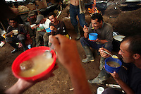 Workers hired by the Colombian government to manually eradicate coca crops have dinner in their camp after a long day of work, in El Campanario, in a remote area of the southern Colombian state of Nariño, on Thursday, June 21, 2007. (Photo/Scott Dalton)