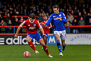 Dan Holman holds up the ball during the The FA Cup match between Aldershot Town and Rochdale at the EBB Stadium, Aldershot, England on 7 December 2014.