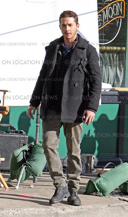 CHICAGO, ILLINOIS - Tuesday 13th November 2007. EXCLUSIVE: Shia Labeouf films a funny scene for his latest movie 'Eagle Eye' which is a serious drama/ thriller about a terrorist cell plotting a political assassination. In this scene Shia Labeouf attempts to get money from an ATM without success then returns to find cash spewing out of the machine. He scrambles to grab as much money as possible then makes a run for it. LaBeouf plays a young slacker type. Photograph: David Buchan/On Location News. Sales: Eric Ford 1/818-613-3955 info@onlocationnews.com