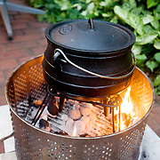 A potjiekos, or dutch oven, is used in a traditional South African braai.  Durban, South Africa