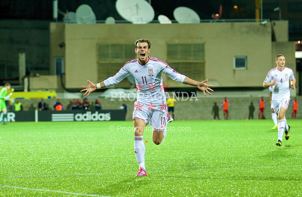 ANDORRA LA VELLA, ANDORRA - Tuesday, September 9, 2014: Wales' Gareth Bale celebrates scoring the second goal against Andorra during the opening UEFA Euro 2016 qualifying match at the Camp d'Esports del M.I. Consell General. (Pic by David Rawcliffe/Propaganda)