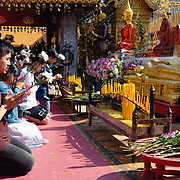 People worshiping at Wat Phra That Doi temple, Chiang Mai