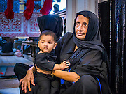 04 NOVEMBER 2014 - YANGON, MYANMAR: A Burmese Shia woman and her child in the Mogul Mosque (Masjid) in Yangon during Ashura services. Ashura commemorates the death of Hussein ibn Ali, the grandson of the Prophet Muhammed, in the 7th century. Hussein ibn Ali is considered by Shia Muslims to be the third imam and the rightful successor of Muhammed. He was killed at the Battle of Karbala in 610 CE on the 10th day of Muharram, the first month of the Islamic calendar. According to Myanmar government statistics, only about 4% of the population is Muslim. Many Muslims have fled Myanmar in recent years because of violence directed against Burmese Muslims by Buddhist nationalists.    PHOTO BY JACK KURTZ