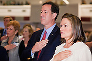 21 FEBRUARY 2012 - PHOENIX, AZ:  Former Senator and Republican Presidential candidate RICK SANTORUM accompanied by his wife, KAREN SANTORUM, say the Pledge of Allegiance at the Maricopa County Lincoln Day lunch in Phoenix. Santorum was in Phoenix Tuesday for an Arizona Republican party leadership luncheon ahead of the state's Republican Presidential Primary election and a CNN Republican Presidential Primary debate, which is Wednesday, Feb. 22.PHOTO BY JACK KURTZ
