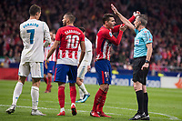 Atletico de Madrid Yannick Carrasco and Lucas Hernanez talking to the referee and Real Madrid XXX during La Liga match between Atletico de Madrid and Real Madrid at Wanda Metropolitano in Madrid, Spain. November 18, 2017. (ALTERPHOTOS/Borja B.Hojas)