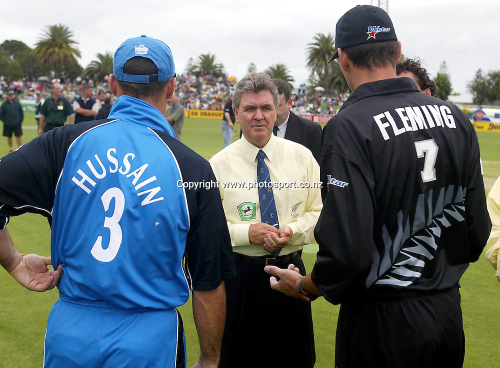 Umpire Doug Cowie with captains Nasser Hussain and Stephen Fleming during the third ODI cricket match between New Zealand and England, 20 February 2002, McLean Park, Napier, New Zealand. Photo: Andrew Cornaga/PHOTOSPORT<br /><br /><br /><br />044183