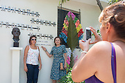 Pilgrims take souvenir photos with a bronze bust of martyred Archbishop Oscar Romero outside his former rectory and home. El Salvador prepares for the beatification ceremony and mass announcing the beatification of Archbishop Oscar Romero. The Archbishop was slain at the alter of his Church of the Divine Providence by a right wing gunman in 1980. Oscar Arnulfo Romero y Galdamez became the fourth Archbishop of San Salvador, succeeding Luis Chavez, and spoke out against poverty, social injustice, assassinations and torture. Romero was assassinated while offering Mass on March 24, 1980.
