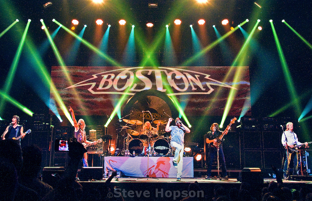 "Boston performing at ACL Live at the Moody Theater, Austin, Texas, July 11, 2012.   Boston is an American rock band from Boston, Massachusetts that achieved its most notable successes during the 1970s and 1980s. Centered on guitarist, keyboardist, songwriter, and producer Tom Scholz, the band is a staple of classic rock radio playlists.  Boston's best-known works include the songs ""More Than a Feeling"", ""Peace of Mind"", ""Foreplay/Long Time"", ""Rock and Roll Band"", ""Smokin'"", ""Don't Look Back"" and ""Amanda."" They have sold over 31 million albums in the United States, of which 17 million are their self-titled debut album and 7 million are their second album, Don't Look Back."