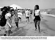 Veronica Webb. Dishes summer beach Games. Atlantic Beach. Amagansett. 8 July '95. Film 95321f30<br />© Copyright Photograph by Dafydd Jones<br />66 Stockwell Park Rd. London SW9 0DA<br />Tel 0171 733 0108