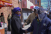 March 14, 2014- Brooklyn, NY- Men greet each other outside the Masjid Al Ihsaan, the mosque on Fulton Street in Clinton Hill, Brooklyn, after Friday midday prayer.- 3/14/2014- Rosa Goldensohn/NY City Photo Wire