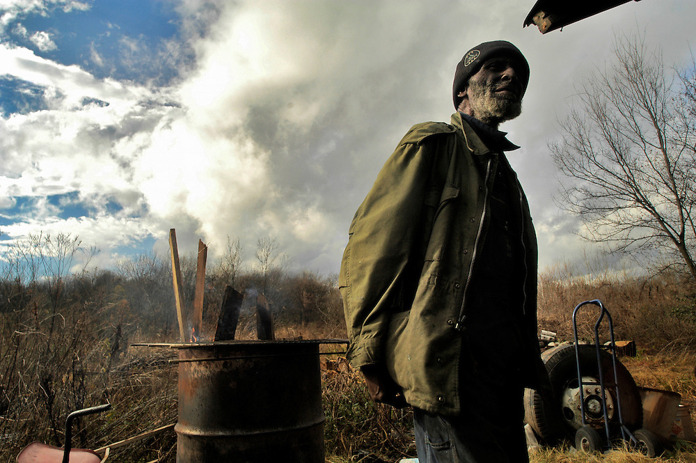 """(photo by Matt Roth).Wednesday, December 10, 2003..""""Some People call this homelessness, but this is wildlife!"""" declares Pearlie Hines describing the unusual life he loves living as a """"junk man."""""""