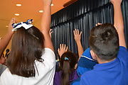 Displaced Robinson ES students at Holland MS receive 500 books from First Book, the Barbara Bush Literacy Foundation, the AFT, and the Houston Federation of Teachers.