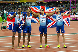 London, August 12 2017 . \A jubilant Great Britain and Northern Ireland team pose for pictures after winning gold in the men's 4x 100m relay on day nine of the IAAF London 2017 world Championships at the London Stadium. © Paul Davey.