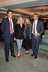 Left to right, WILLIAM & VIOLET VESTEY and the HON.PEREGRINE & SERENA HOOD at a party to celebrate the publication of 'Let's Eat meat' by Tom Parker Bowles held at Fortnum & Mason, Piccadilly, London on 21st October 2014.