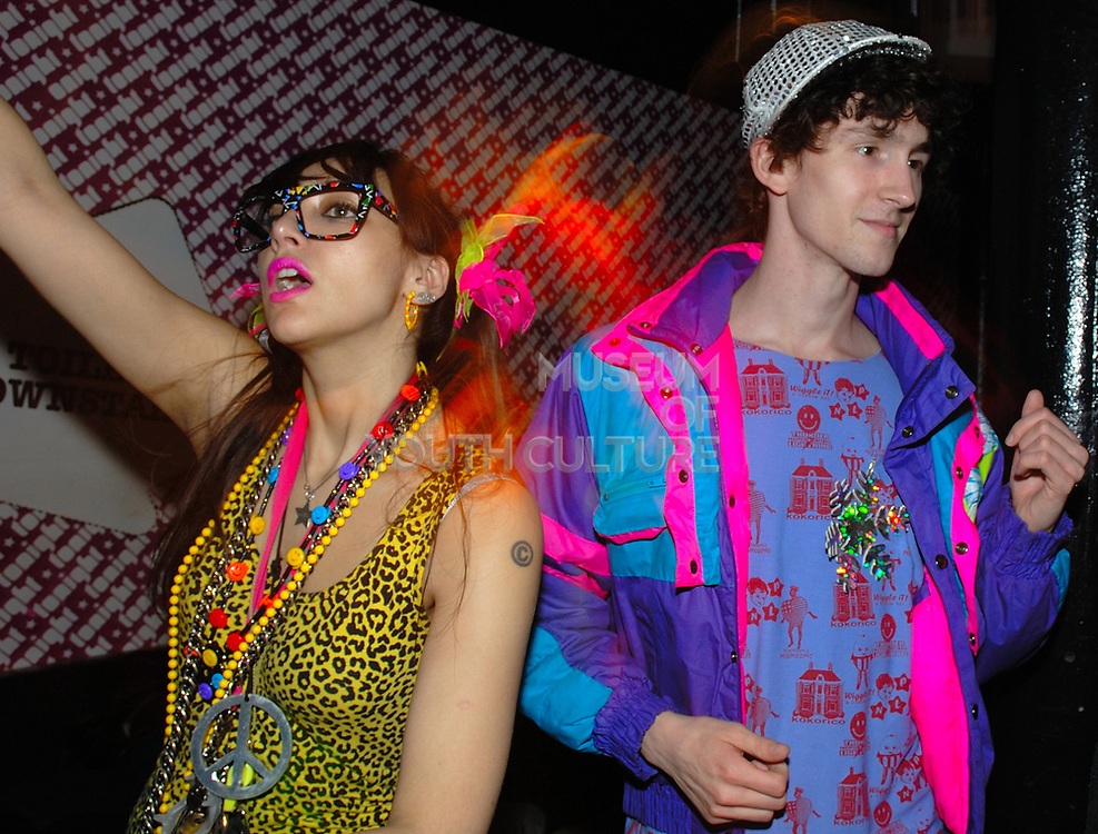 Namalee Bolle and a guy wearing New Rave styles, Anti-Social, London December 2006
