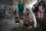 Following the recent military assault by the Pilipino authorities on Muslim rebels in North Cotabato, some of the 160,000 displaced persons have started to return to their villages...Others are hold up in displacement camps in the province. The Muslim community have set up camp in a disused warehouse outside the town of Pikit. The warehouse has no sanitation or running water and is home to more than 2000 Muslim displaced men, women and children...They have received some food from the World Food Programme (WFP) and today the International Red Cross (IRC) delivered some much needed assistance with sanitation and water storage...In all but one of the camps visited Muslims and Christians are seeking refuge in separate camps...Violence began after a deal to expand the Muslim autonomous zone was blocked by the Philippines Supreme Court. Rebels from the Moro Islamic Liberation Front (MILF) occupied some 15 villages in the region triggering a retaliatory assault by the Philippine army involving heavy artillery and air support...The military has pulled back to established camps but locals (CBO Volunteers) opposed to the Muslim rebels have taken up arms to defend their land from repeat incursion by the rebels..