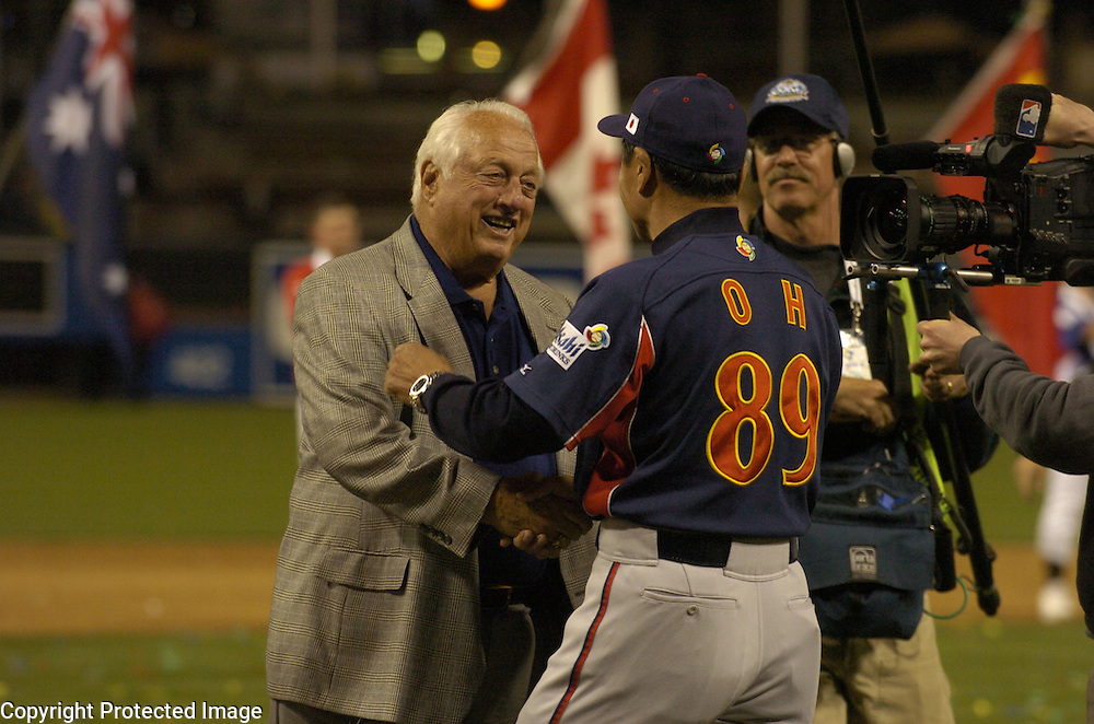 WBC Ambassador Tommy Lasorda (L) congratulates Team Japan manager Sadaharu Oh (R) after beating Team Cuba 10-6 in Final action of the World Baseball Classic at PETCO Park, San Diego, CA.