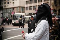 Masked Iraq War protester stands in front of police officer in San Francisco, CA. Copyright 2008 Reid McNally.
