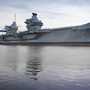Aircraft Carrier HMS Queen Elizabeth at the naval dockyard in Rosyth as it leaves the dry dock for the first time.<br /> <br /> <br /> &copy; John Linton<br /> All rights reserved