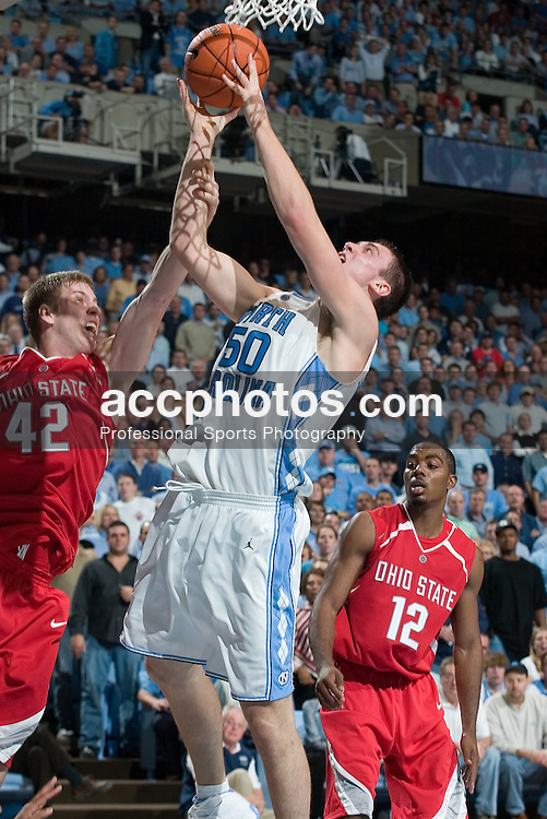 29 November 2006: Tar Heel forward (50) Tyler Hansbrough defended by Buckeye forward (42) Matt Terwilliger during a 98-89 North Carolina Tar Heels victory over the Ohio State Buckeyes, in the Dean Smith Center in Chapel Hill, NC.<br />